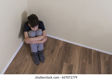 Young man in depression. Sad teenager boy. Sad depressed boy in an empty room. stressed out male teenager. Negative human emotion. Young people and emotions concept. teen depression, pain, suffering.