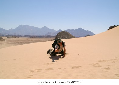 young man in desert, sand