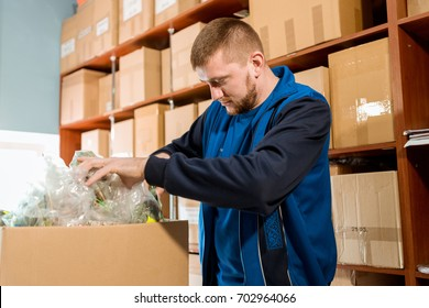 Young man in a distribution warehouse