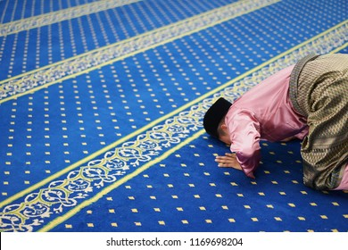 A young man do sujud (prostration) to god (Allah) in direction at the Kaaba at Mecca during the daily or sunnah prayer