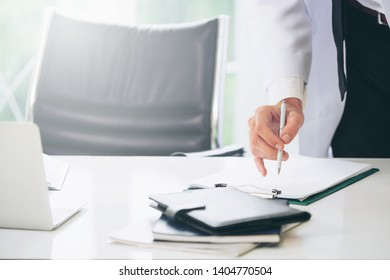 Young man doctor working at office desk in hospital. Medical and healthcare concept.
