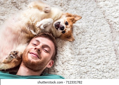 the young man with a dog is played. close up portrait