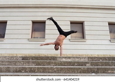 Young man doing acrobatics in outdoor location