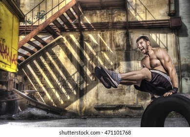 Young man doing balance exercise on street background