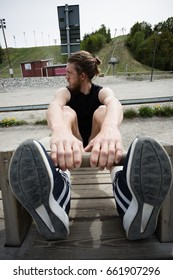 young man doing crunch exercise in outdoors gym. curl-up  technique demonstrated by young athlete