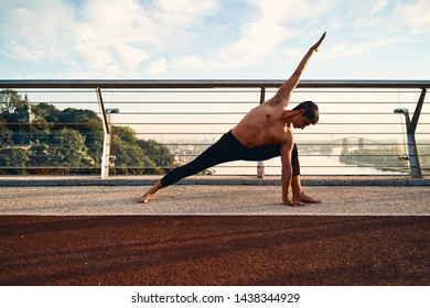 Young man doing exercise early in the morning on a pathway