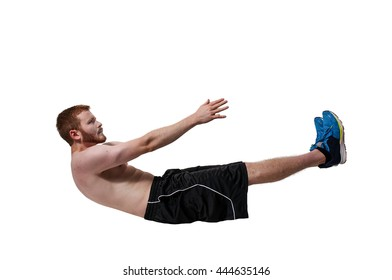 Young man doing exercises by doing crunches
