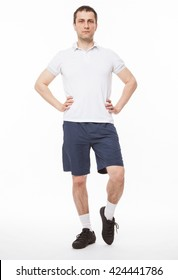 Young man doing exercises, white background