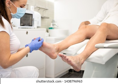 young man doing pedicure in salon. Beauty concept