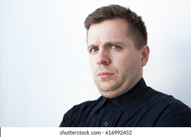 young man with a double chin in black t-shirt. Problems with proper nutrition