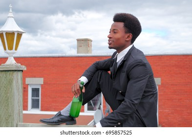young man drinking alcohol on roof terrace suit and tie handsome success