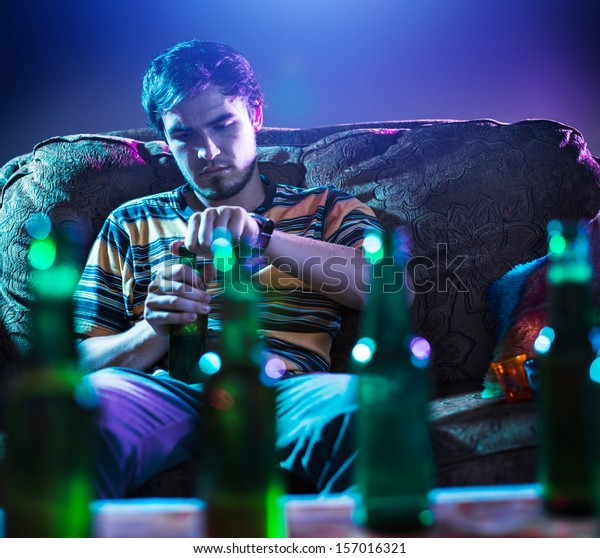 young man drinking beer alone
