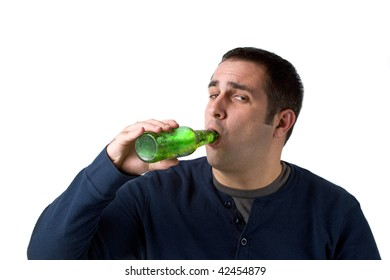 A young man drinking a bottle of beer isolated over a white background.