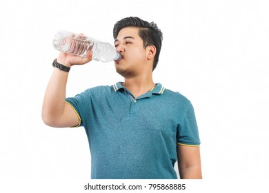 Young man drinking water.
