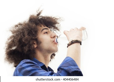 Young man drinking water from glass bottle