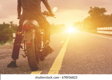 Young man drive with motorbike on street, enjoying freedom and active lifestyle, having fun on a bikers tour.