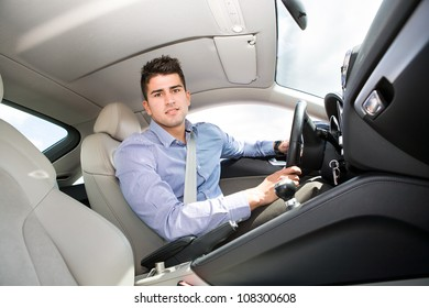 a young man driving the car