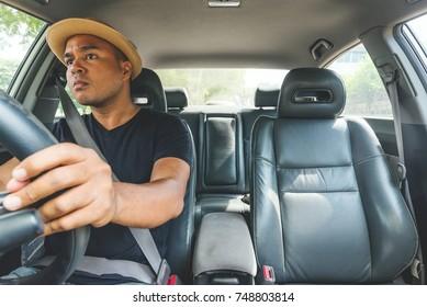 Young man driving car carefully