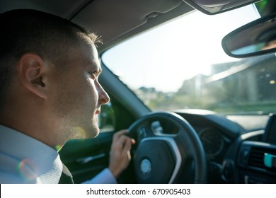 young man driving an expensive car