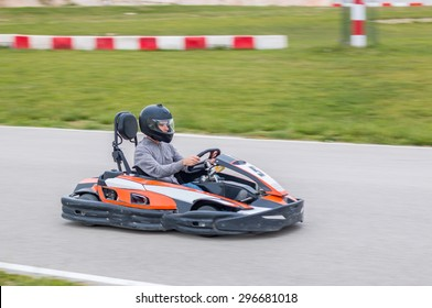 Young man driving a kart in a race