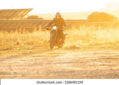 young man driving motorbike
