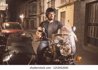 Young man driving sidecar in the street