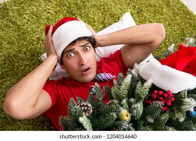 Young man drunk at home after christmas party