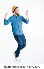 Young man in earphones dancing holding smart phone isolated on the white background