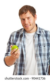 Young man eating an apple - healthy diet concept