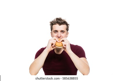 young man eating a fast food hamburger isolated on white