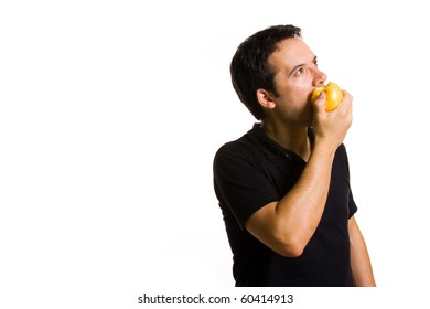 Young man eating a fresh red apple, isolated on white