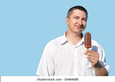 A young man eating ice cream, he is happy smiles, isolation