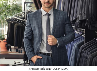 Young man in elegant suit at menswear store