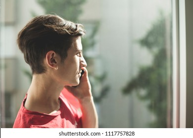 Young man, emotionally talking on the phone,