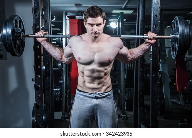 young man is engaged in bodybuilding at the gym