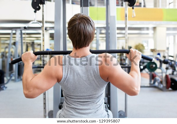 Young man is engaged in the gym