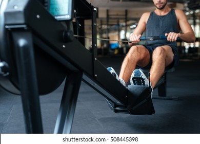 Young man is engaged in gym. cropped photo