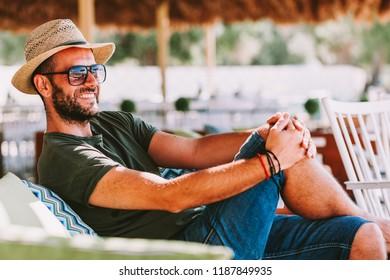 Young man enjoying in the beach bar