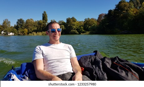 Young Man enjoying a boat ride on the Müggelsee Lake in Berlin, Germany.