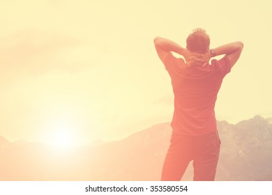 Young man enjoying the freedom in nature. - Shutterstock ID 353580554