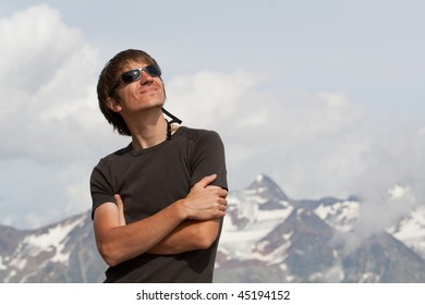 Young man enjoying the sun high in the mountains