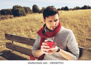 Young man enjoying a sunny morning drinking a cup of coffee