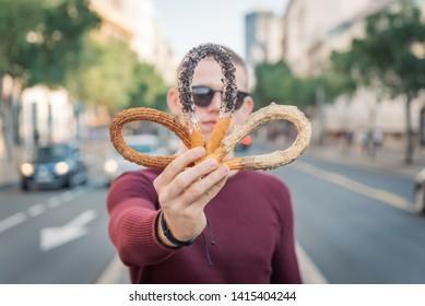 Young man enjoying in sweet food