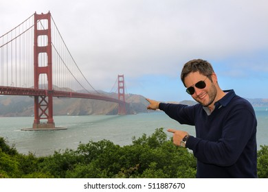 a young man enjoying time and famous sightseeing in san francisco - golden gate bridge