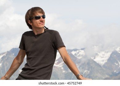 Young man enjoying the view high in the mountains