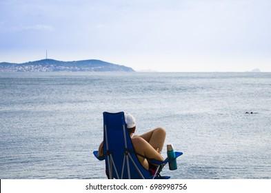The young man enjoys the beach