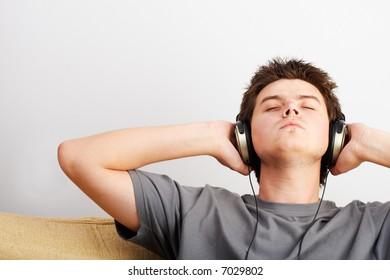 Young Man enjoys listening music in headphones