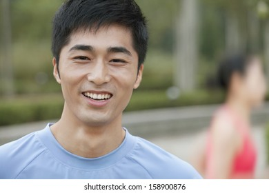 Young man in exercise clothing in park