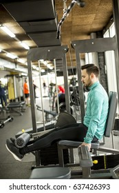 Young man exercise on an exercise machine at the gym