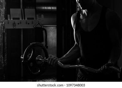 Young man is exercising at the gym